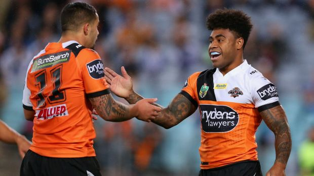 Good work: Kevin Naiqama is congratulated by Josh Aloiai after scoring.