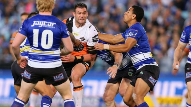 Hard yards: Tim Grant takes the ball up during the Tigers' loss to the Bulldogs.