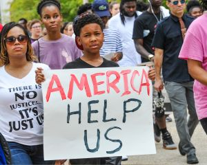 Protesters hold signs in Baton Rouge, Louisiana.