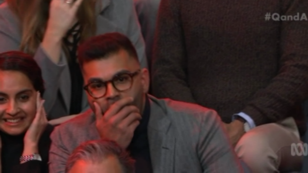 Tarang Chawla listens as Steve Price responds to his question on Q&A.