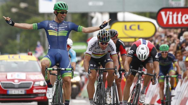 Australia's Michael Matthews (left) celebrates as he crosses the finish line head of Peter Sagan of Slovakia, (centre) ...