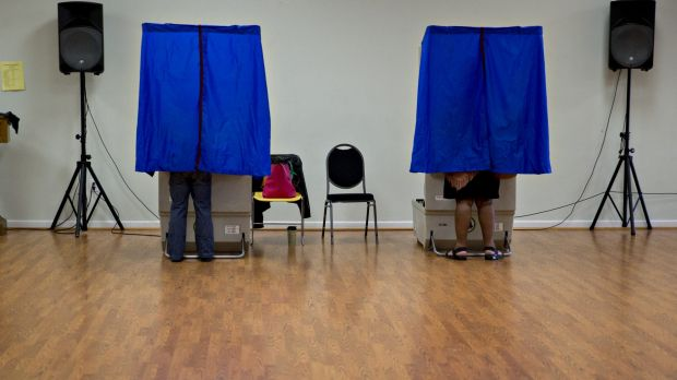 Residents use an electronic voting machine at a polling location in Philadelphia, Pennsylvania, US.