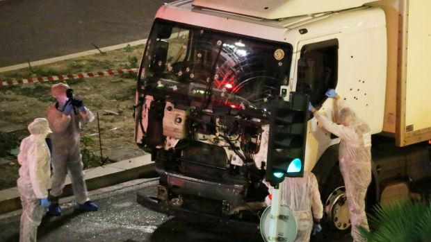 Authorities investigate a truck after it ploughed through Bastille Day revellers in the French resort city of Nice on ...