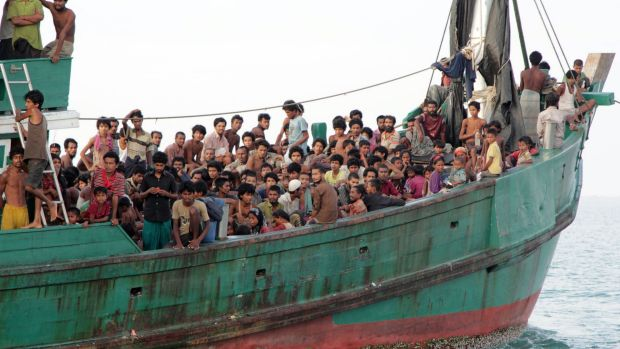 Migrants including Myanmar's Rohingya Muslims wait to be rescued by Aceh fishermen off Indonesia last year.