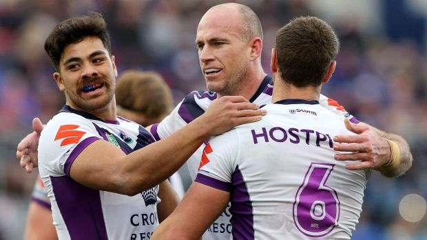 Matt White of the Storm celebrates a try with teammates at Hunter Stadium.