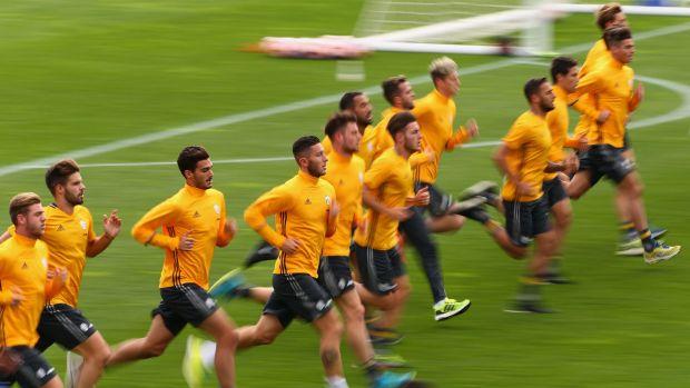 Players run laps during a warm up after the Juventus FC welcome ceremony at Lakeside Stadium.