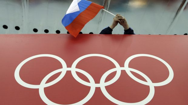 A Russian flag flutters over the Olympic rings at the 2014 Winter Games in Sochi.