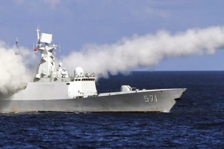 A Chinese missile frigate Yuncheng launches an anti-ship missile during a military exercise in the waters near south ...