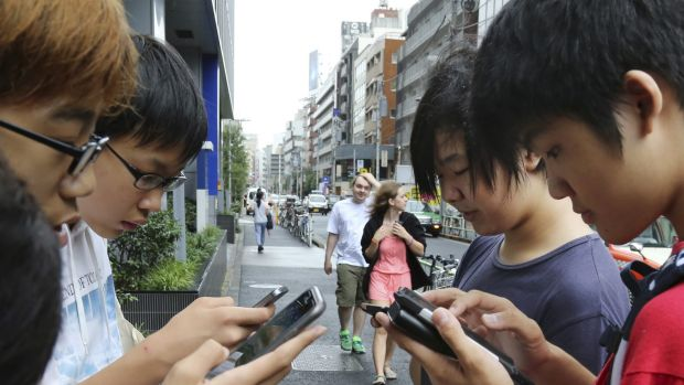People getting into the newest fad in gaming: Pokemon Go.