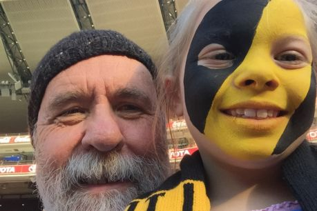 Martin Flanagan and his granddaughter Annie at the footy.
