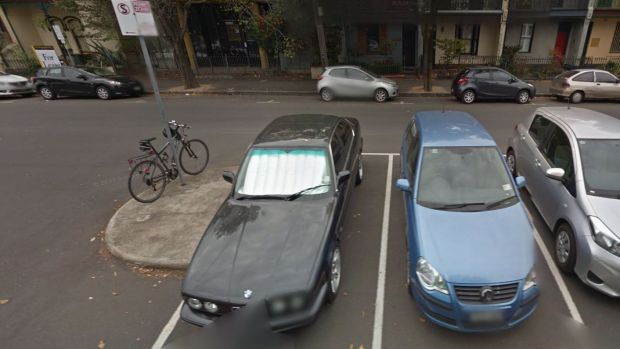 Google Street View from April, 2014 showing Mark Anderson's blue Volkswagen Polo in one of the set of eight permit zone ...