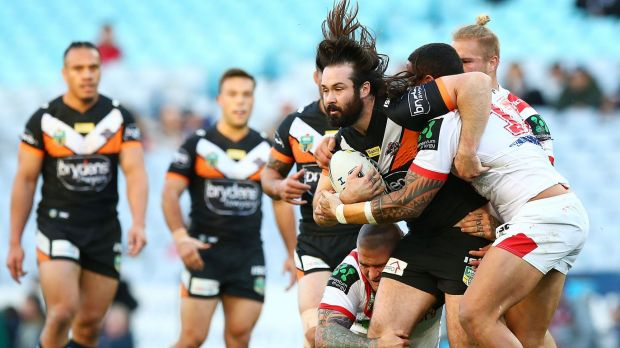 Strong run: Aaron Woods surges ahead for the Tigers.