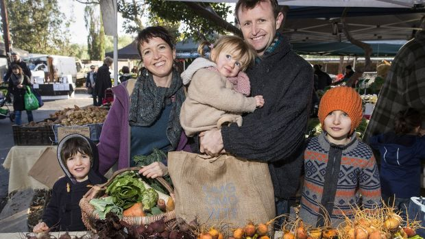Lauren Dircks and Andrew Casey shopping at the Abbotsford Convent farmers market in Melbourne with their children, Gus ...