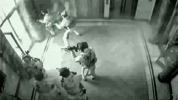 CCTV shows tactical police entering the Lindt cafe at 2.13am on December 16, 2014.