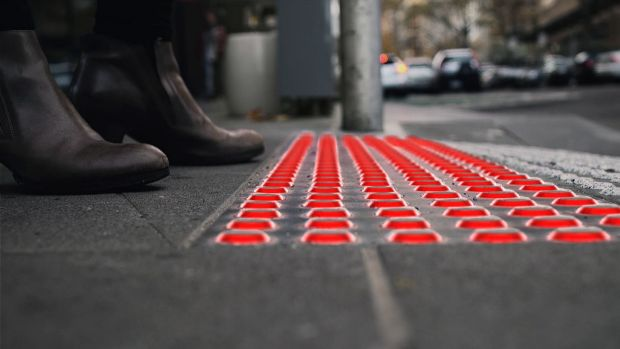 Buro North's Smart Tactile Paving warns distracted pedestrians when to stop.