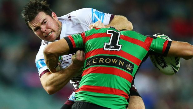 Jamie Lyon of the Sea Eagles tackles Cody Walker of the Rabbitohs.