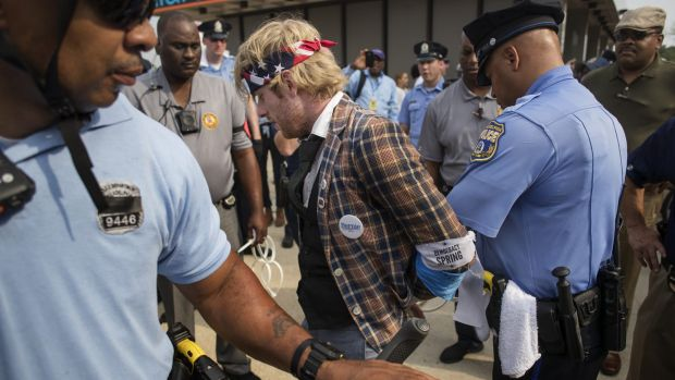 A protester is arrested on the first day of the Democratic National Convention.