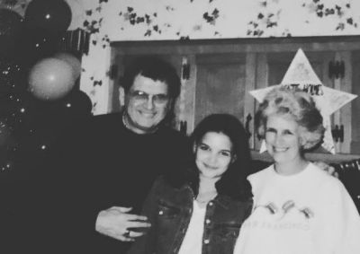 """Katie Holmes shared this throwback photo with the caption: """"#tbt my incredible parents and me....high school days❤️ ..."""