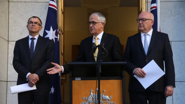 Prime Minister Malcolm Turnbull and Attorney-General George Brandis at last week's announcement naming Brian Martin as ...