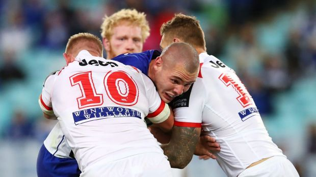 Collision: David Klemmer is tackled by the Dragons defence.