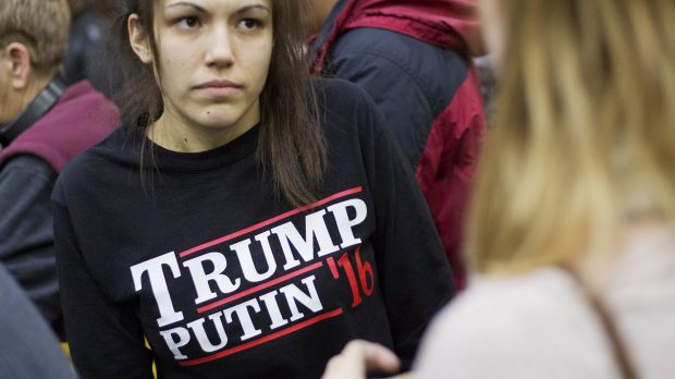 A woman wears a shirt reading 'Trump Putin '16', hinting at the presidential candidate's rumoured support of the Russian ...