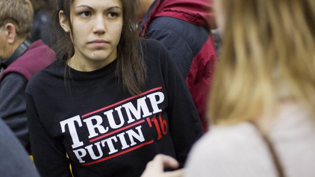 A woman wears a shirt reading 'Trump Putin '16' while waiting for Republican presidential candidate Donald Trump at ...