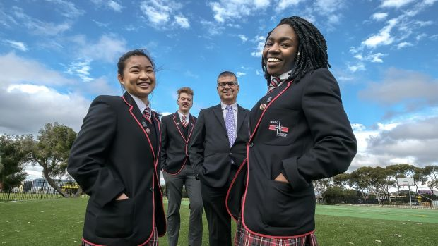 North Geelong Secondary College year 12 students  Mary Salazar, school captain Joel O'Keefe,  principal Nick Adamou and ...