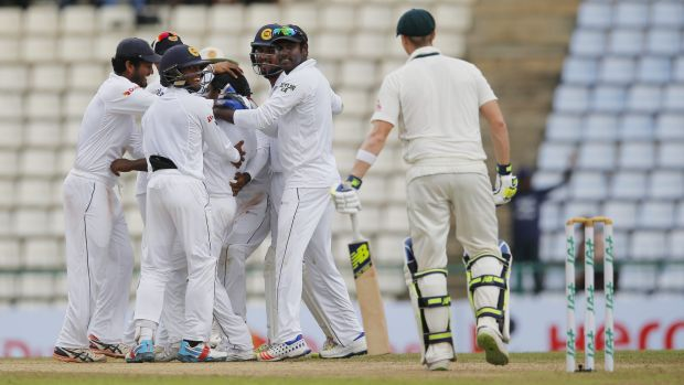 Sri Lanka celebrates the dismissal of Australia's Steve Smith on day five.