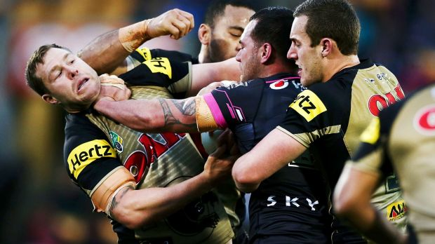 Getting stuck in: Bodene Thompson gets to grips with Trent Merrin.