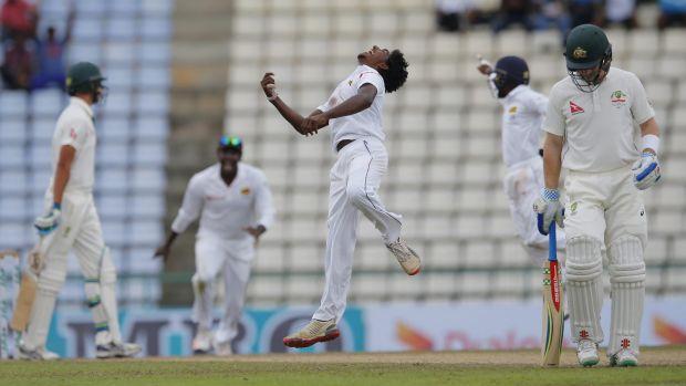 Sri Lanka's bowler Lakshan Sandakan celebrates the dismissal of Australia's Mitchell Starc.