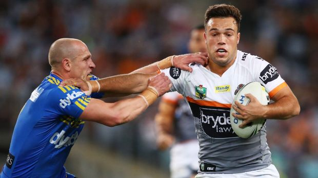 Tiger Luke Brooks attempts to fend off Eels half Jeff Robson in their NRL clash at ANZ Stadium.