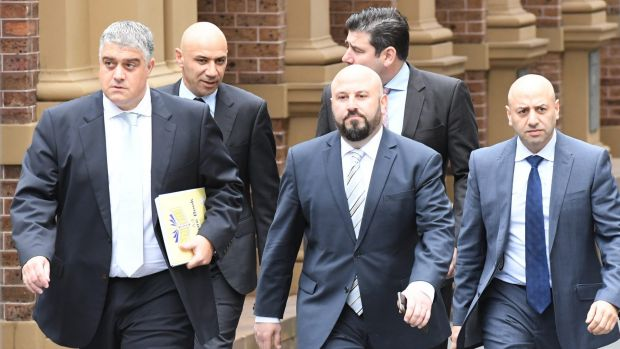 From left, Nick Di Girolamo, Moses Obeid, Eddie Obeid jnr, solicitor Tim Breene and Paul Obeid at the Supreme Court on a ...