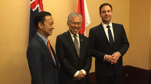 Australian Trade Minister Steve Ciobo (right), meets with former Indonesian trade minister Thomas Lembong (left) and new ...