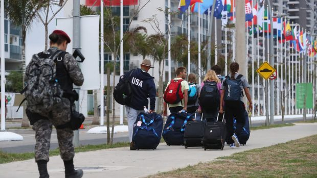A security officer patrols as athletes arrive at the Olympic Village ahead of the Rio 2016 Olympic Games.