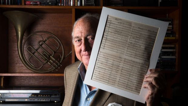 Peter Wall holding his and and Tony Ansell's score of the old theme music for ABC News.