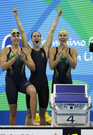 Australia's Emma McKeon, Brittany Elmslie and Bronte Campbell celebrate as Cate Campbell, bottom, finishes the women's ...