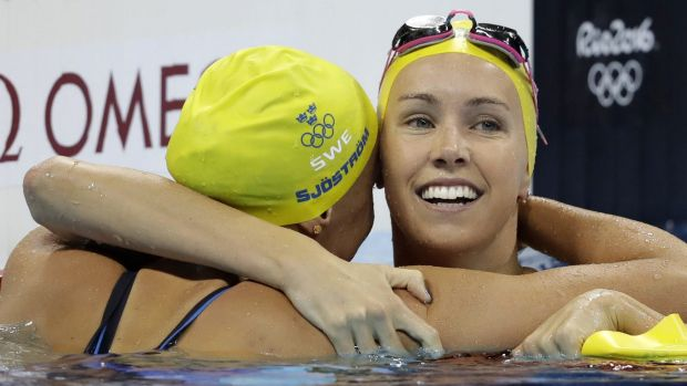 Missing out: Emma McKeon (right) congratulates Sweden's gold medal winner Sarah Sjostrom after the Swede set a world ...