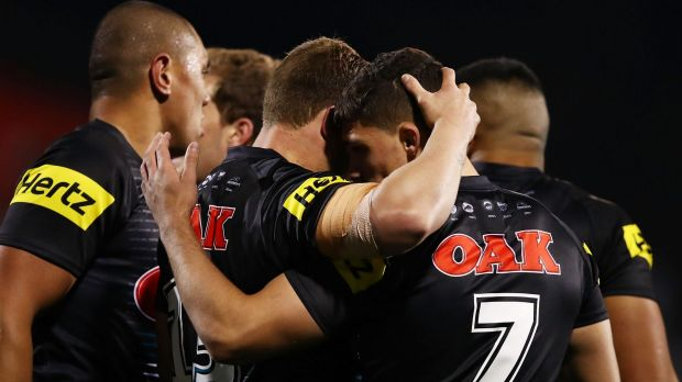 Well done: Nathan Cleary celebrates with Penrith teammates after scoring.
