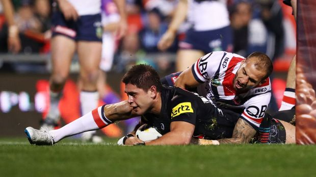 Sliding into home: Chris Grevsmuhl scores a try during the round 22 NRL match between the Penrith Panthers and the ...
