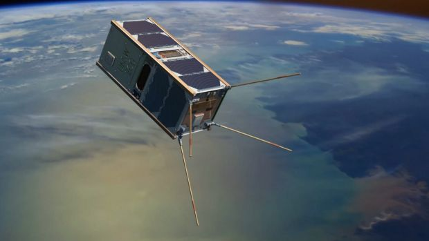 An artist's impression of an Australian mini-satellite orbiting Earth.