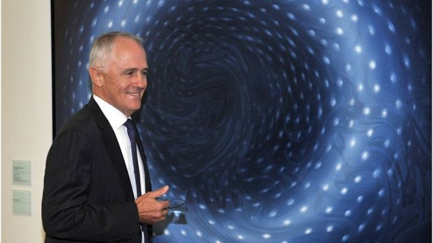 "Malcolm Turnbull in front of Megan Walch's artwork, ""Blue Donut"", at Parliament House."