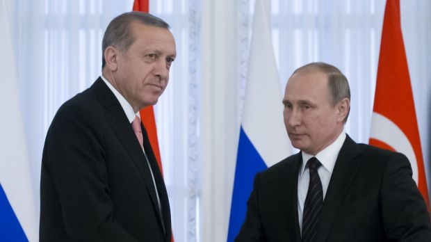 Russian President Vladimir Putin, right, and Turkish President Recep Tayyip Erdogan shake hands after talks outside St ...