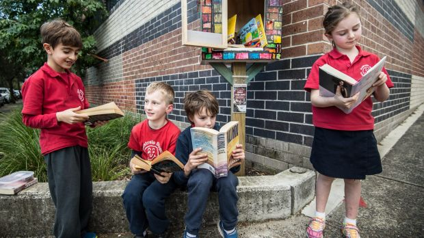 Students from Australia Street Infant School taking books from their Street Library.