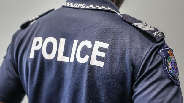 Police have charged a man after he allegedly attacked officers in Townsville.