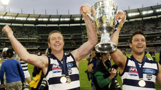 Premiership Cats: Johnson celebrates the 2007 flag with Jimmy Bartel.