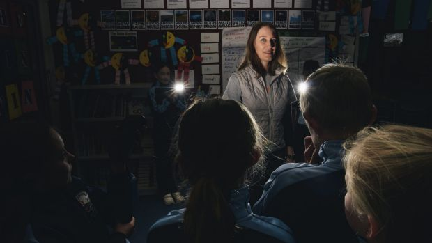 Canberra teacher Bronwyn Nuske with her year 3 class at Holy Spirit Primary School.