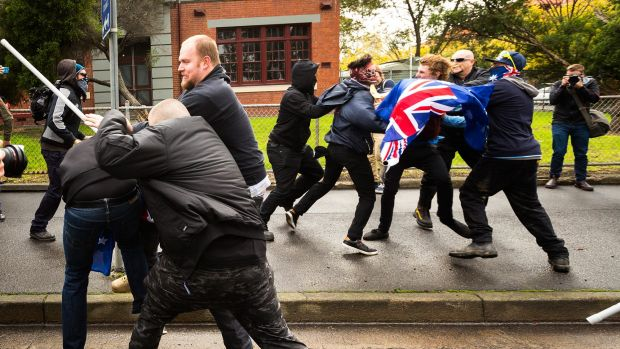 Protesters from rival anti-racism and anti-Islam groups clash in Coburg in May.