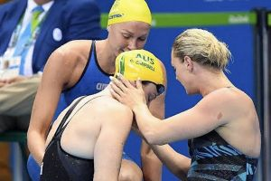 Cate Campbell is comforted by Sweden's Sarah Sjostrom and Denmark's Jeanette Ottesen after her shock 100m loss.