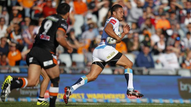 On the break: Hayne shows the Tigers a swift pair of heels.
