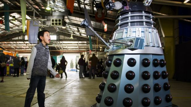 Kenneth Le, 10, with one of the Daleks that roamed the Old Bus Depot Markets.